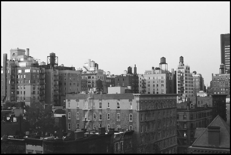 A black and white photo of an industrial cityscape